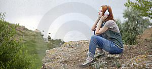 Young Girl With Headphones At Rock Stock Photo - Image: 15403380