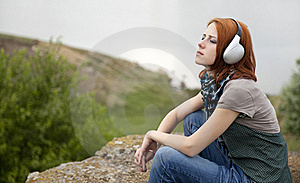 Young Girl With Headphones At Rock Stock Photo - Image: 15403390