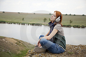 Young Girl With Headphones At Rock Royalty Free Stock Photo - Image: 15403405
