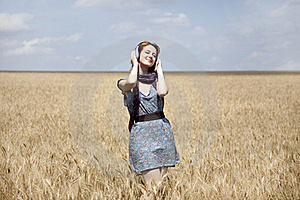 Young  Smiling Girl With Headphones At Field. Stock Image - Image: 15403831