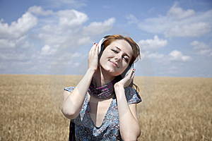 Young  Smiling Girl With Headphones At Field. Royalty Free Stock Photography - Image: 15403857