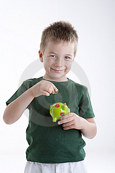 Little Boy Depositing Money In His Piggy Bank. Stock Photography - Image: 15409622
