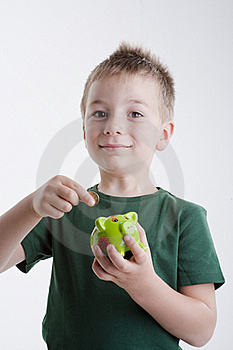 Little Boy Depositing Money In His Piggy Bank. Royalty Free Stock Photography - Image: 15409747