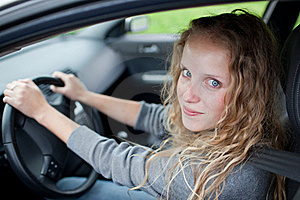 Pretty Young Woman Driving Her  Car Royalty Free Stock Photos - Image: 15418758