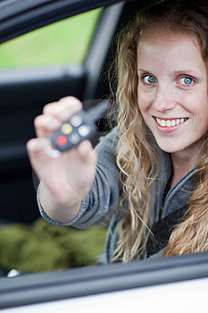 Pretty Young Woman Showing Off Her Brand Car Royalty Free Stock Photography - Image: 15418897