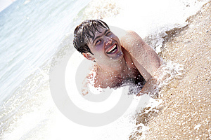 Young Smiling Men On Waves At Beach. Stock Photos - Image: 15430283