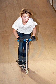 Boy With Scooter In Skate Hall Stock Photo - Image: 15435560
