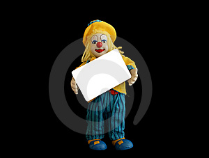Figurine Of The Clown With A Blank Credit Card Royalty Free Stock Photo - Image: 15443605