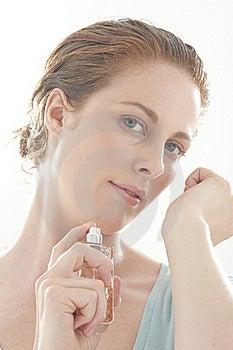 Woman Spraying Perfume Stock Image - Image: 15453601