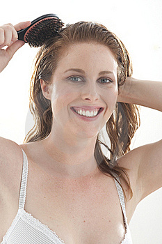 Woman Brushing Hair Stock Photos - Image: 15454343