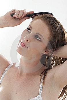 Woman Brushing Hair Royalty Free Stock Photography - Image: 15454397