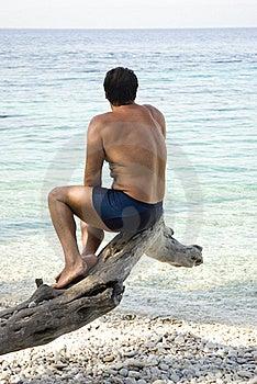 Man Sitting On Beach Stock Image - Image: 15455771