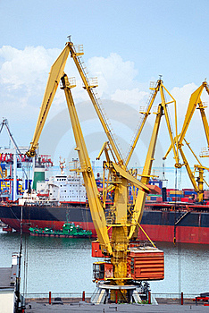 The Trading Seaport With Cranes, Cargoes And Ship Royalty Free Stock Images - Image: 15456119