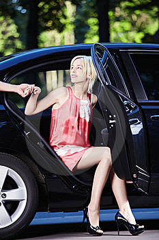 A Beautiful Girl Comes Out Of The Car Stock Photos - Image: 15456943