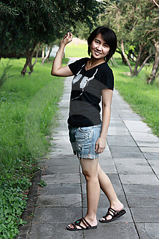 Asian Woman Smiling In The Park Royalty Free Stock Image - Image: 15458356