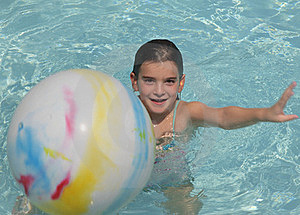 Girl Playing Ball In Pool Royalty Free Stock Photos - Image: 15471118