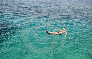 Man Floating In The Sea. Stock Photo - Image: 15472100