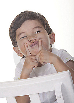 Little Boy Makes A Funny Face. Royalty Free Stock Photo - Image: 15480375