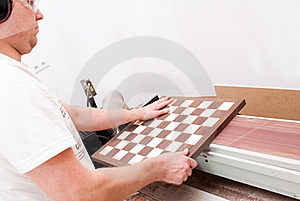Carpenter Working On An Electric Buzz Royalty Free Stock Image - Image: 15504076