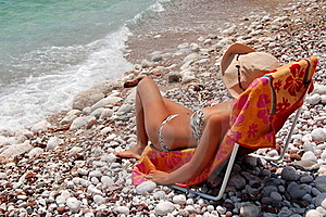 Quiet Moments On A Rocky Adriatic Beach Stock Photography - Image: 15524752