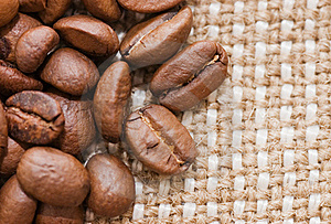 Brown Coffee Grains On A Sacking Royalty Free Stock Photo - Image: 15526875