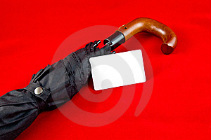 Umbrella With Card On Red Background Stock Photography - Image: 15537162