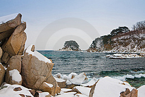 Snow-covered Rocks At The Sea Royalty Free Stock Image - Image: 15539286