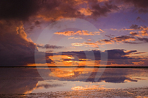 Cloudy Sunset Over The Ocean Stock Images - Image: 15539854