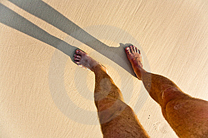 Feet Of Man With Shadow At The Beach Royalty Free Stock Image - Image: 15541346