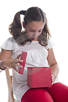 Girl Surprised With A Gift Box Stock Photos - Image: 15541583