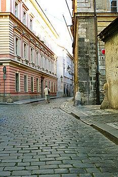 Men Is Walking  Between Houses Royalty Free Stock Image - Image: 15550046
