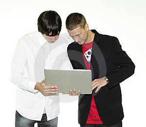 Two Businessmen Looking At Laptop Royalty Free Stock Images - Image: 15550279