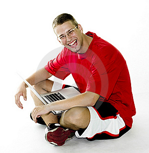 Young Man Sitting With Laptop, Laughing Royalty Free Stock Photography - Image: 15550397