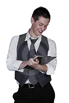 Young Man Writing On Clipboard, Studio Sho Stock Photo - Image: 15564750