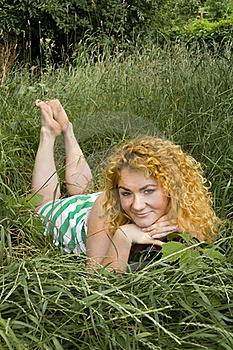 Young Red-haired Girl Lying In The Grass Stock Image - Image: 15567931