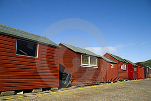 Red Beach Huts, Blue Sky Royalty Free Stock Photography - Image: 15568937