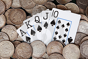 Royal Flush And Stacks Of Silver Dollars Royalty Free Stock Images - Image: 15571139