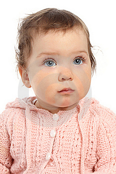 Cute Little Baby In A Pink Jumper Looks Up Royalty Free Stock Photography - Image: 15574067
