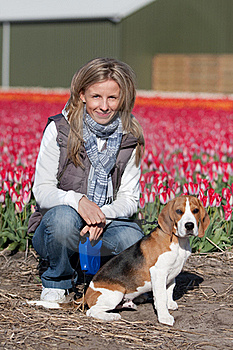 Girl With Her Dog On Flower Field Royalty Free Stock Images - Image: 15582649