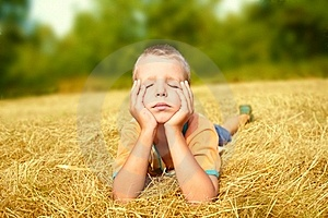 Young Boy Laying On Ground Stock Photo - Image: 15583380