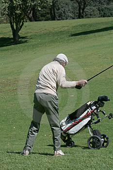 Old Golfer And Cart Stock Photo - Image: 1561230
