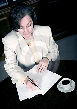 Business woman working in her office Royalty Free Stock Photo