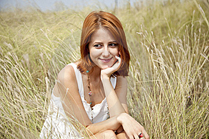 Beautiful Red-haired Girl At Grass Stock Photography - Image: 15607952