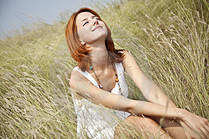 Beautiful Red-haired Girl At Grass Stock Image - Image: 15607981