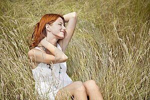 Beautiful Red-haired Girl At Grass Royalty Free Stock Images - Image: 15608009