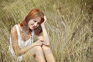 Beautiful Red-haired Girl At Grass Royalty Free Stock Photography - Image: 15608027