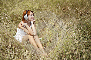 Beautiful Red-haired Girl At Grass With Headphones Royalty Free Stock Photo - Image: 15608145