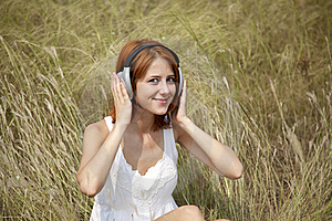Beautiful Red-haired Girl At Grass With Headphones Stock Image - Image: 15608161