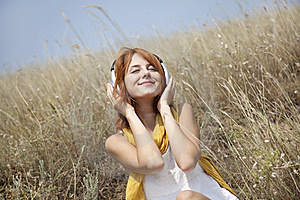 Beautiful Red-haired Girl At Grass With Headphones Stock Photography - Image: 15608182