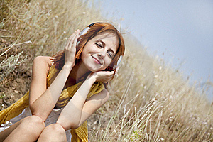 Beautiful Red-haired Girl At Grass With Headphones Stock Images - Image: 15608204